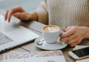 hot cappucino with laptop on the table